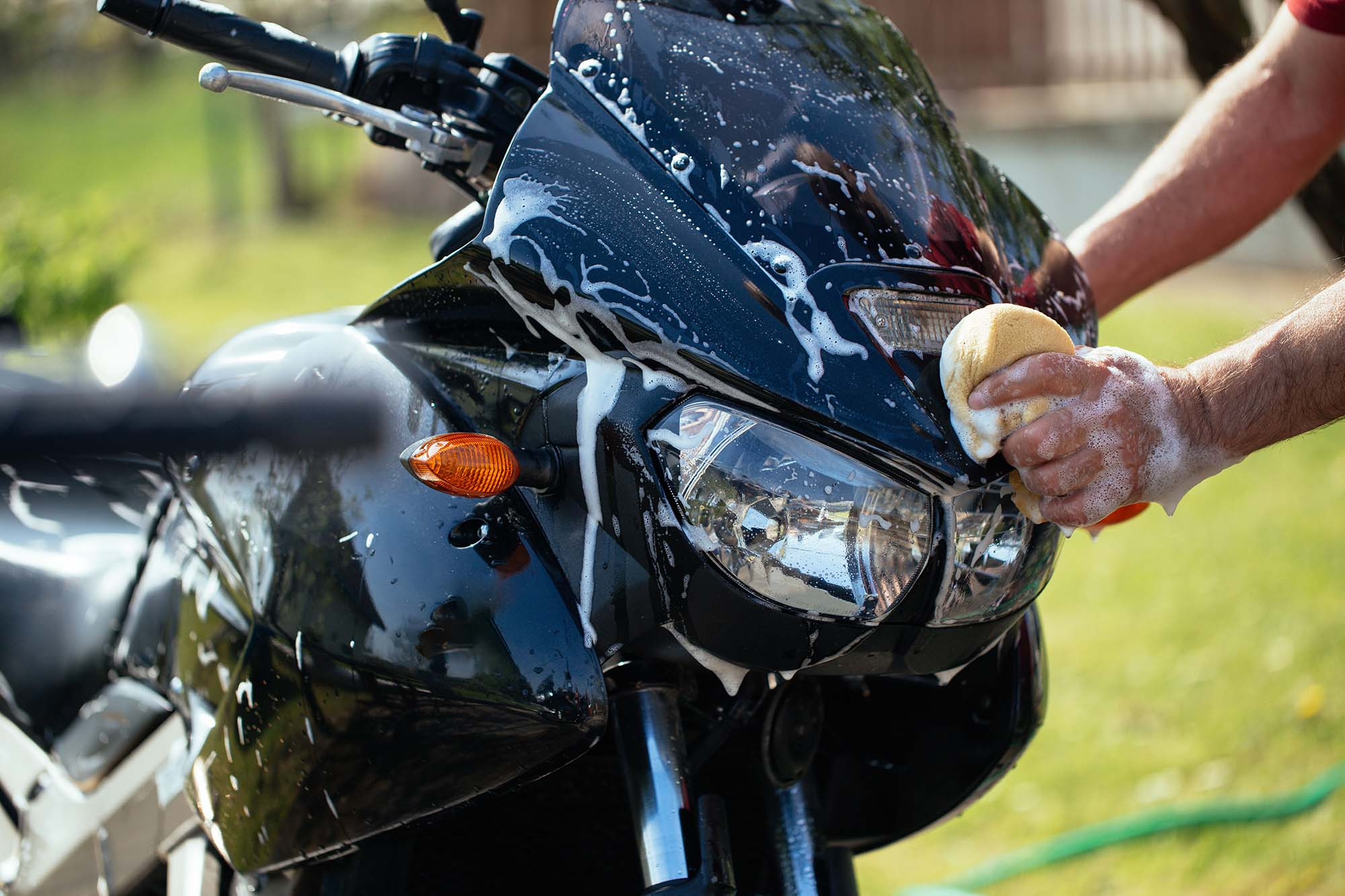clean motorcycle windscreen using big soft sponge but motorcycle are awesome